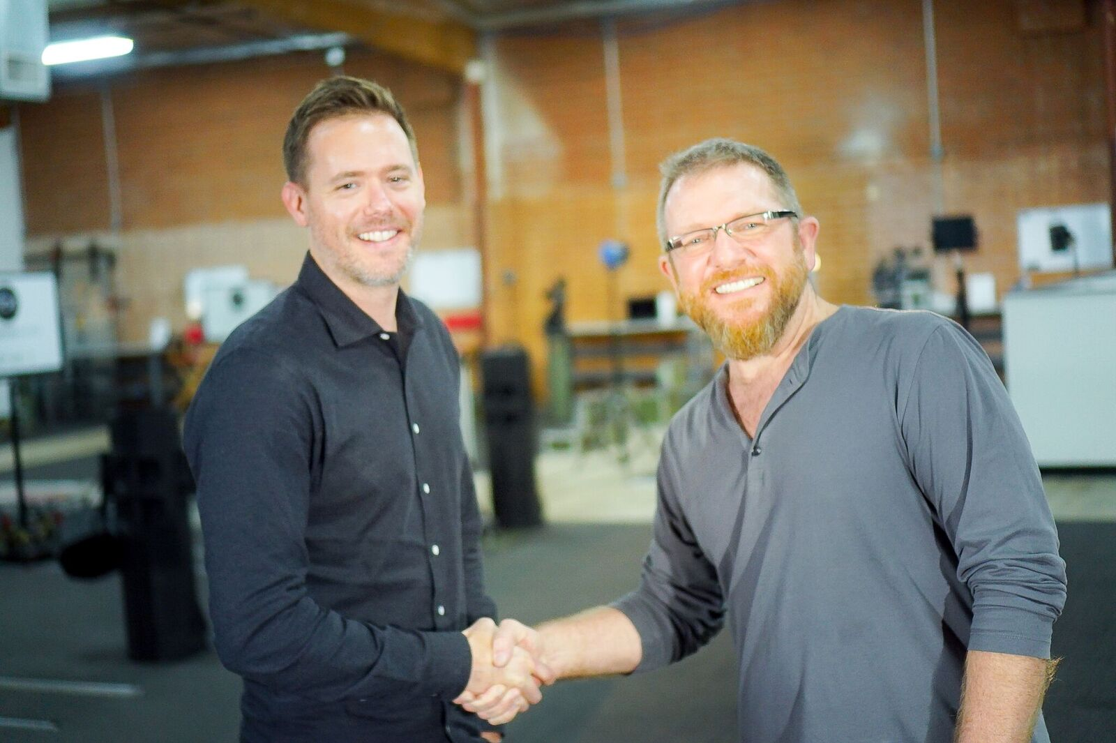 The Camera Division owners shaking hands